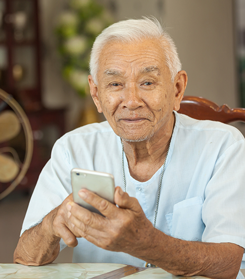 Older man using cellphone